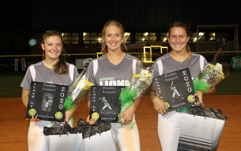 Senior softball players (from left) Kaleigh Fowler, Jaden Cheek and Kalyn Jinks were honored Sept. 18 following Franklin County's 4-1 win over East Hall. (Photo courtesy of Candace Oliver)