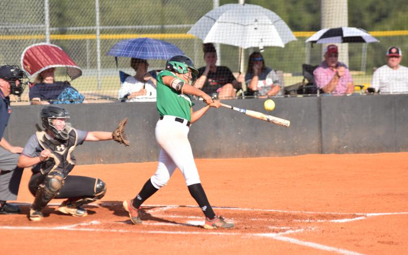 Jayden Gailey gets one of her hits during Wednesday's game against Jackson County.