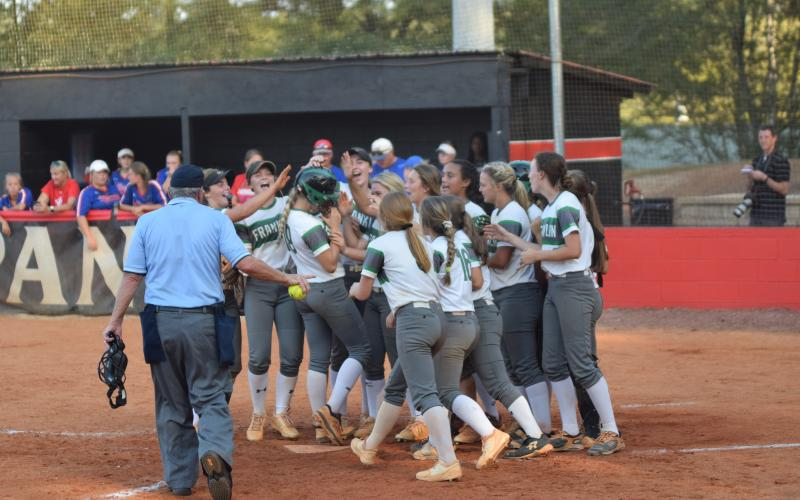 The Franklin County Lady Lions, pictured celebrating a Jaden Cheek home run during the region championship game, will host Coahulla Creek Wednesday for a doubleheader in the first round of the state tournament.