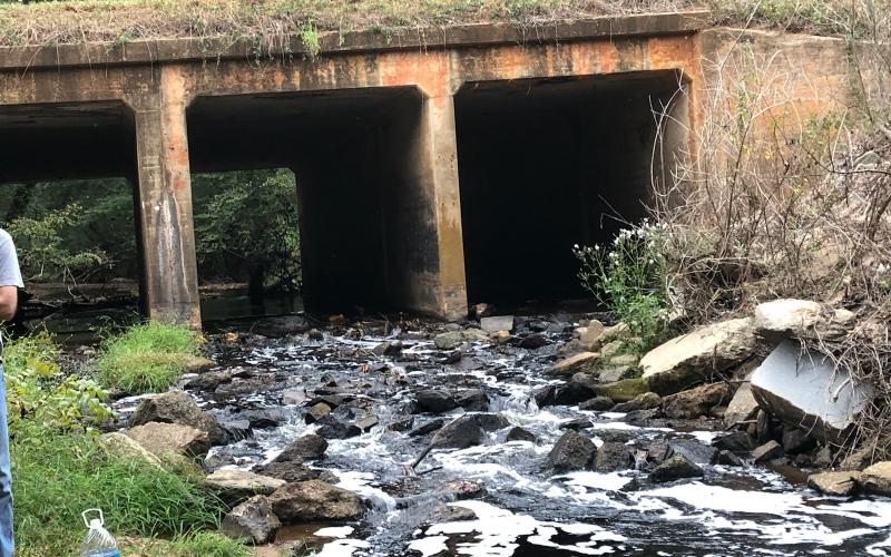 Residents along Indian Creek sent in photos of water in the stream running black Saturday due to what was found to be runoff from efforts at the GRP energy plant on Highway 198 to keep fires down in the plant's wood pile that is being kept for fuel.