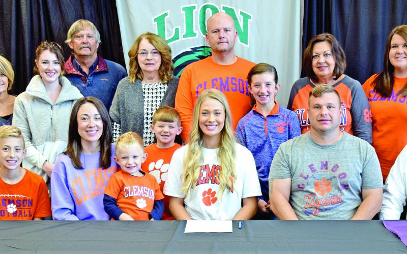 Pictured at Jaden Cheek's scholarship signing with Clemson University last week are (front, from left) Carson Cheek, Megan Cheek, Cullen Cheek, Jaden Cheek, Jeff Cheek, Joe Cheek, (back) Joey Cheek, Sherri Cheek, Alex McLeroy, Mike Carson, Ellene Carson, Tucker Ruark, Matt Ruark, McKinlee Turner, Terri Cheek and April Ruark. Jaden is also the granddaughter of the late Raynell Cheek.