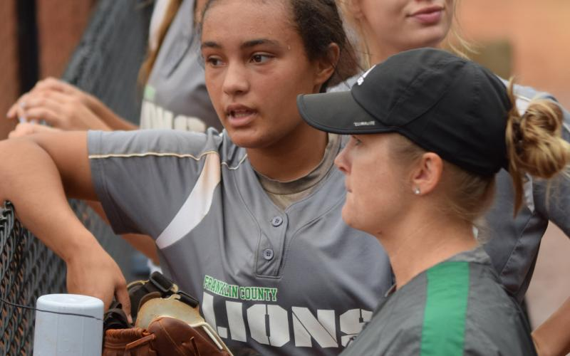 Sophomore Jayden Gailey talks with Franklin County Lady Lion assistant softball coach Cherokee Bell. Gailey has been named Class AAA State Player of the Year for the second year in a row.