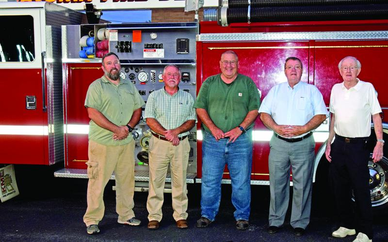 Former Lavonia Fire Chiefs gathered Tuesday to honor the retiring Scott O'Barr. Pictured are (from left) O'Barr, Bob White, Jones Beasley, Mike O'Barr and Tommy Cole. (Photo by Scoggins)