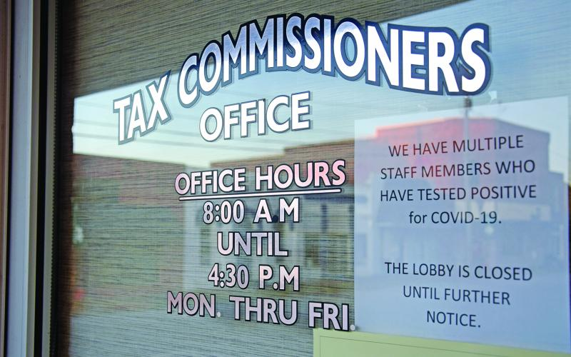A note on the door of the Franklin County Tax Commissioner's Office informs taxpayers that the office is closed due to a coronavirus outbreak among staff members. (Photo by Scoggins)