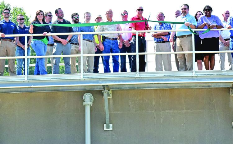 Franklin County and Carnesville city officials were joined by engineers and contractors in a ribbon-cutting ceremony (above) Tuesday at the county's new wastewater treatment plant in Carnesville. A tour of the plant was held after the ribbon cutting. (Photo by Scoggins)