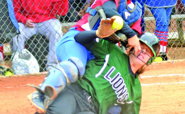 Seniors Kalyn Jinks (sliding in safely during last year's state semifinals), Kaleigh Fowler and Jaden Cheek will be counted on for leadership as the Franklin County Lady Lions set out to defend their Class AAA state championship.