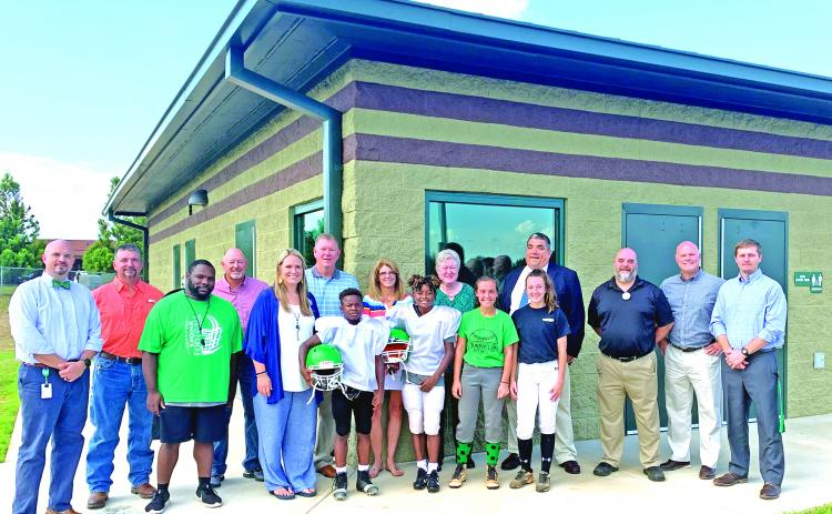 Franklin County Middle School has a new field house. Pictured in front of the new building are FCMS Principal C.J. Wilder, Board of education member Alan Mitchell, FCMS Head Football Coach Jim Allen, BOE member Randall Gailey, FCMS Assistant Principal Kasey Haley, BOE member Eric Burrell, A.J. Elliott, Mylan Roebuck, MacCall Davis, Kenzleigh Fain, BOE member Jo Beth James, BOE member Robin Cato, Franklin County Schools Superintendent Chris Forrer, Assistant Superintendent Chuck Colquitt, Assistant Superinte
