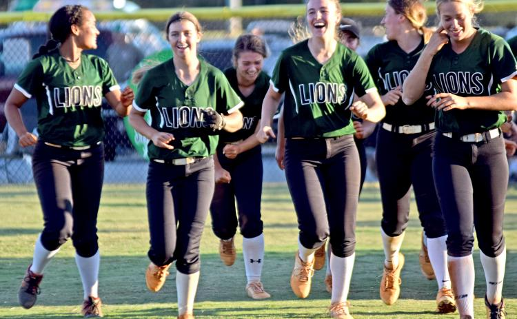 The Franklin County Lady Lions celebrate on the field Thursday after eliminating Coahulla Creek with a 14-0 win at FCHS.