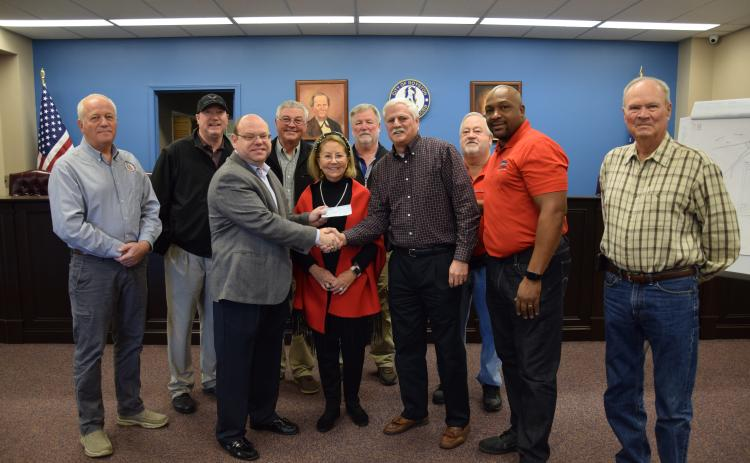The city of Royston received a donation Thursday from Steve and Robin Williams. Pictured at the presentation of the $50,000 check are (front, from left) Royston Mayor David Jordan, Robin Williams, Steve Williams, Council members Keith Turman and Wayne Braswell, (back) City Manager Ed Andrews, Council members Matt Fields, Larry Bowen, Lee Strickland and Kenneth Roach. The money will be used to continue planning and construction of an amphitheater at the Royston Wellness and Community Park. (Photos by