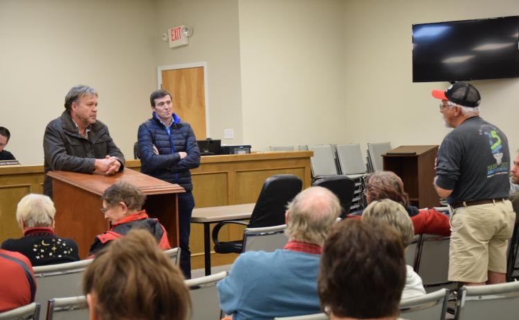 Rodney Black (right), who lives near the Georgia Renewable Power plant near Carnesville, tells GRP officials David Groves (right) and Ciaran McManus (center) about noise and smell problems at the plant during one of many Franklin County Commissioner meetings attended by the plant's neighbors during the second half of 2019.